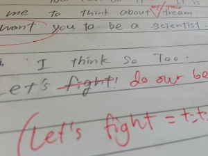This kid was trying to be encouraging. He/she didn't know that Japanese ファイト (faito, 'try hard, do your best') and English 'fight' are not the same in all contexts.