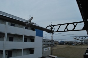 View from my 3rd Japanese apartment: rice paddies, other apartment buildings and laundry pole