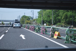 Roadwork barriers in Japan are usually cuter than these bowing characters.